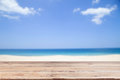 Wood floor on blur clear sky and island beach Summer background. Royalty Free Stock Photo