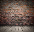 Wood floor and brick grunge wall background Royalty Free Stock Photo