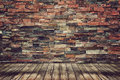 Wood floor and brick wall for vintage wallpaper empty Royalty Free Stock Image