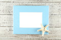 Wood frame on white wooden background. Royalty Free Stock Photo