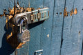 Wood gate with lock run down has a steel on it selective focus is on the Royalty Free Stock Images