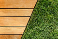 Wood and grass divided by a diagonal Royalty Free Stock Photo