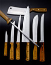 Wood handle chef knives and cutlery Royalty Free Stock Photo
