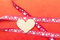 Wood heart with gift ribbon Royalty Free Stock Photo
