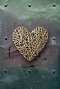 Wood heart on old metal background photo of a wooden top of Royalty Free Stock Image