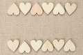 Wood hearts on hessian texture background, valentine background Royalty Free Stock Photo