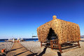 Wood hut on summer beach of sea. Resort Royalty Free Stock Images