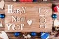 Wood inscription Happy New Year on wood board.