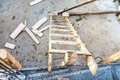 Wood ladder on construction site, tools and concrete renovation Royalty Free Stock Photo