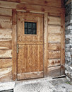Wood main door of a ancient walser in valsesia Stock Photos