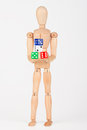 Wood mannequin holding colorful block dice