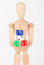 Wood mannequin holding colourful block dice isolated on white background Royalty Free Stock Photo