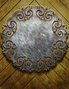 Wood and metal ornament on old wooden background vintage collection Stock Image