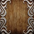 Wood and metal ornament on old wooden background vintage collection Stock Photo