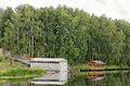 Wood and metal shed on the pond in summer Stock Image
