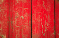Wood panel with chipped red paint. Grunge Style Stock Photo