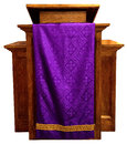 Wood pedestal church pulpit common sight church christian religion purple robe adds color symbol holy things isolated white Stock Photography