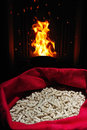 Wood pellets canvas sack stove flame Royalty Free Stock Photo