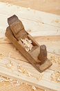 Wood plancks, plane and wooden shavings Royalty Free Stock Photo