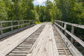 Wood plank bridge old crossing a stream on a gravel logging road in remote maine woods Stock Photography