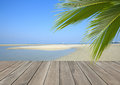 Wood plank over beach with coconut palm tree Royalty Free Stock Photo