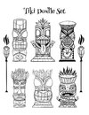 Wood Polynesian Tiki idols, gods statue carving, torch. Royalty Free Stock Photo