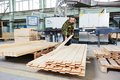 Wood processing manufacture worker of operating on woodworking machine Stock Photo