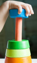 Wood pyramid toy with baby hand Royalty Free Stock Photo