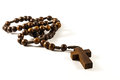 Wood rosary and cross with isolated background Royalty Free Stock Photos