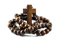 Wood rosary and cross with isolated background Royalty Free Stock Photography
