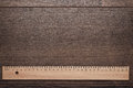 Wood ruler on the wooden background Royalty Free Stock Photo