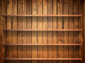 Wood shelf on wood wall Stock Photos