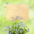 Wood Sign with Flowers / empty board for your text /  on light-g Stock Photos
