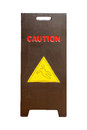 Wood sign showing warning of caution wet floor Royalty Free Stock Images
