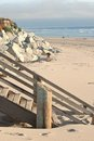 Wood stairs and rocks on beach in California Royalty Free Stock Photography
