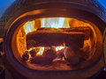 Wood stove and wood burning inside logs in fire Stock Images