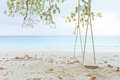 Wood swing and white sand beach Royalty Free Stock Photos