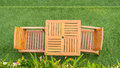 Wood table and chair table on grass Royalty Free Stock Photo
