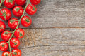 Wood table with cherry tomatoes and copyspace Stock Photo