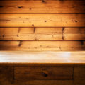 Wood table with drawer against wooden wall Royalty Free Stock Photography