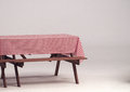 Wood table and red napkin for outdoor party. Royalty Free Stock Photo