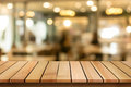 Wood table top on blur bokeh cafe background can be used for dis Royalty Free Stock Photo