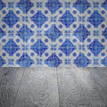 Wood table top and blur vintage ceramic tile pattern wall Royalty Free Stock Photo