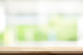 Wood table top on blur white green kitchen window background Royalty Free Stock Photo