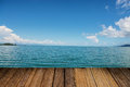 Wood table top on blurred blue sea background - can be used for display or montage your products