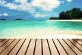 Wood table top on blurred sea beach white sand on sea