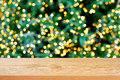 Wood table top with bokeh background from decorative light on christmas tree Royalty Free Stock Photo
