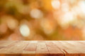 Wood table top on brown bokeh abstract background blur Stock Photos