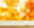 Wood table top on shiny bokeh gold background