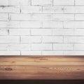 Wood Table And White Brick Wal...